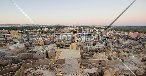 Extreme long shot for Shali City The ancient city of Siwa Oasis at magic hour