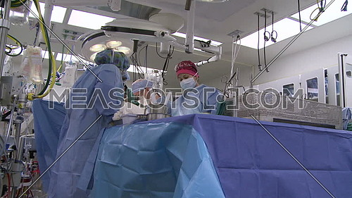Low angel shot of surgical team preforming surgery