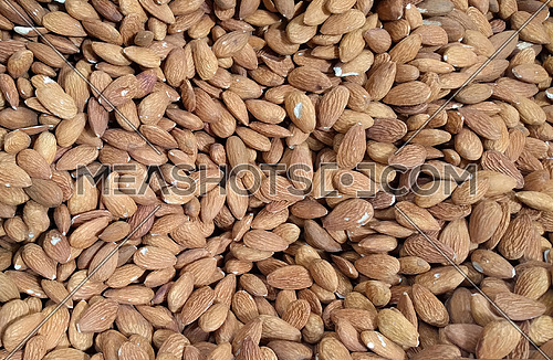 Almonds seamless texture background .Close up almond nuts natural protein food and for snack , top view