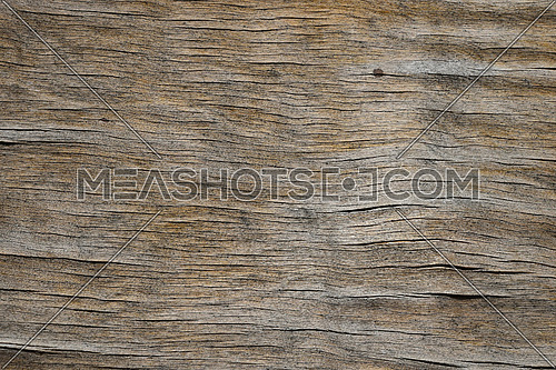 Old vintage brown wooden faded aged flat board with cracks, checks and other defects and color shades