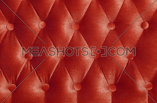 Scarlet ruby red capitone textile background with buttons, retro Chesterfield style soft tufted fabric furniture upholstery diamond pattern decoration, close up
