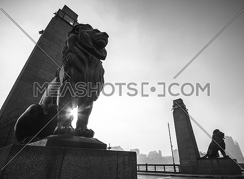 black and white shot of two lions at Qasr El Nil Bridge - Cairo, Egypt