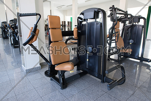 Equipment And Machines At The Modern Gym Room Fitness Center