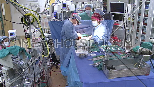 crane down for operation room and medical team performing surgery
