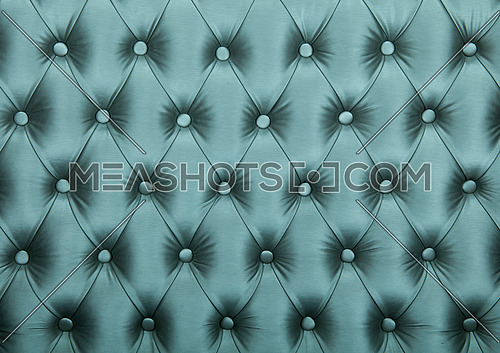 Silver blue teal capitone textile background, retro Chesterfield style checkered soft tufted fabric furniture diamond pattern decoration with buttons, close up