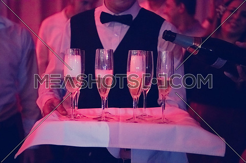 new year office party celebration event Man pours champagne drink in wineglasses