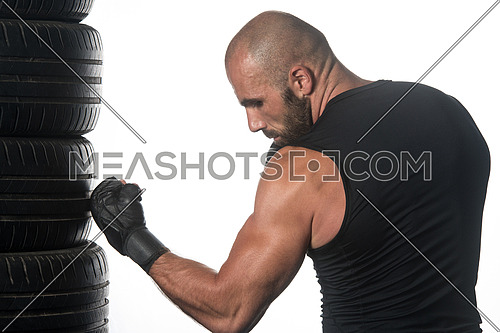 Muscular Sports Guy Boxing Workout Over White Background Isolated - Boxer Is Hitting A Rubber