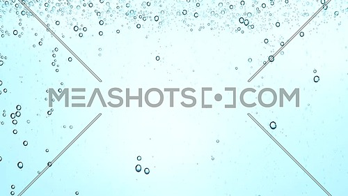 Extreme close up full frame background of pure clear sparkling water with gas in glass, low angle side view, slow motion