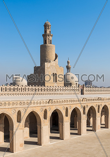 Minaret Ibn Tulun Mosque with helical outer staircase with dome of Amir Sarghatmish mosque in the background, Sayyida Zaynab district, Medieval Cairo, Egypt
