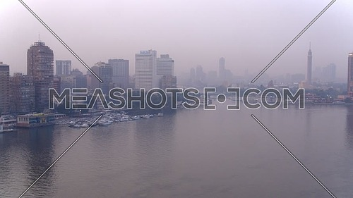 Fly over Shot Drone for The river Nile revealing Al manial Area, Cairo Tower and Sofitel Hotel  in 22th of March 2018 at Cairo.