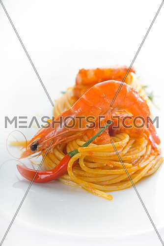 italian spaghetti pasta and fresh spicy shrimps sauce over white