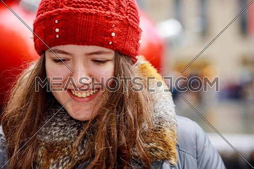 Close up portrait of beautiful smiling girl with brown hair wearing a hat