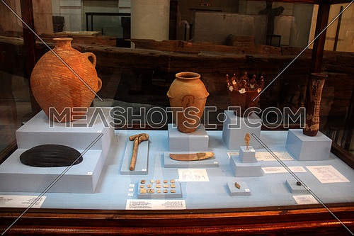a photo from inside the Egyptian museum showing tools & pots used by the ancient Egyptians during the Pharaoh civilization