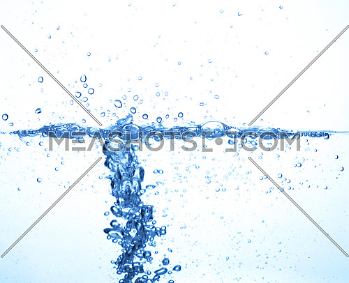 Close up water surface splashing with bubbles and drops isolated on white background, low angle underwater view