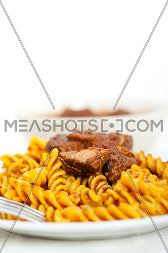 fusilli pasta al dente with neapolitan style ragu meat sauce very different from bolognese style