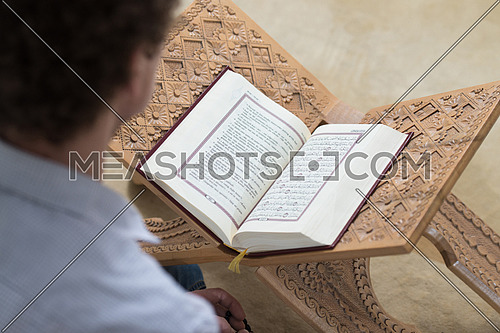 A man reading a translated quran