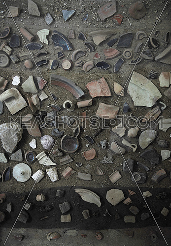 broken pottery pieces on the ground