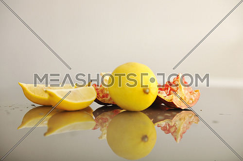 fresh and healthy fruit food lemon and Pomegranate isolated on white