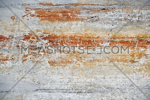 Grunge uneven grey concrete surface background texture with stains of rust