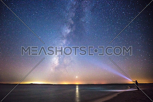 Exploring the milky way by the sea using a torch