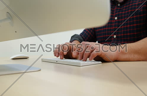 Young Businessman Hands Typing On Computer Keyboard in startup office