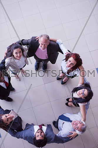 top view of multi ethnic  business people group as team  standing in circle and joining hands