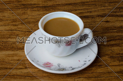 cup of coffee on a wooden table top