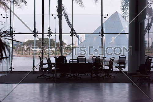 empty modern office with laptop computer on table