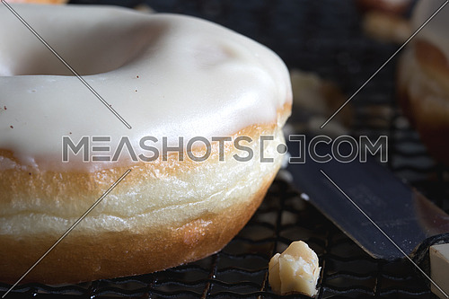 Donuts with nuts and knife beside it
