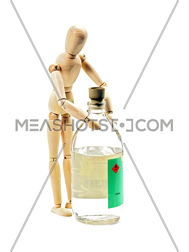 wood mannequin with flammable liqiod on glass bottle isolated on white background