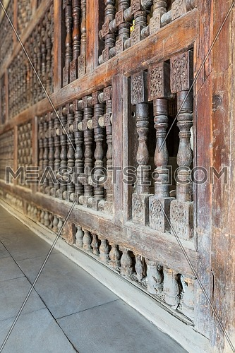 Angle view of interleaved wooden ornate wall - Mashrabiya - at Qalawun Complex, Moez Street, Cairo, Egypt