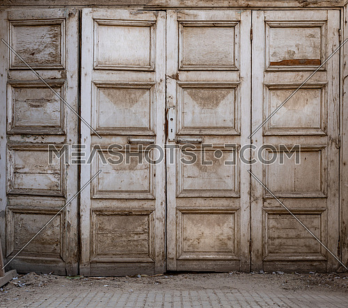 Wooden grunge weathered abandoned door painted in white