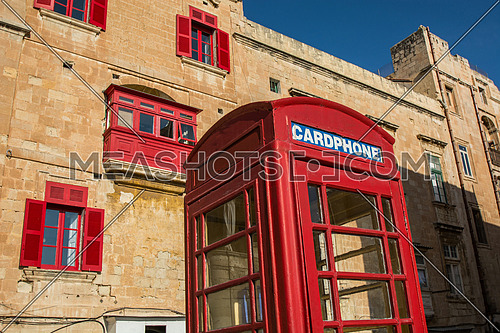 Red telephone cabin in the old town of Vialleta