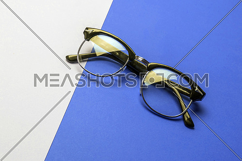 Vintage glasses on colorful background, conceptual image