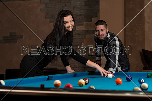 Young Caucasian Man Receiving Advice On Shooting Pool Ball While Playing Billiards