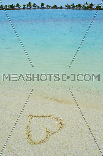 tropical beach nature landscape scene with white sand at summer with a heart shape on the sand