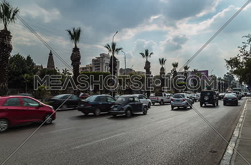 Zoom IN Shot for traffic at Salah Salim Street showing Le Baron Palace in background at Daytime
