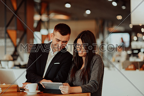 modern man and woman use modern devices, laptop, tablet and smartphone and arrange new projects for the job