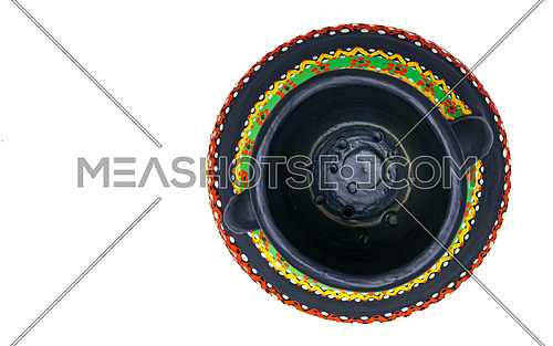 Top view of a black Egyptian handcrafted artistic pottery jar on a white background