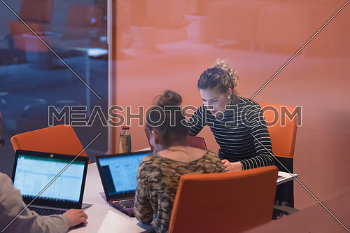 startup businesswomen using laptop computers preparing for next meeting  in creative office