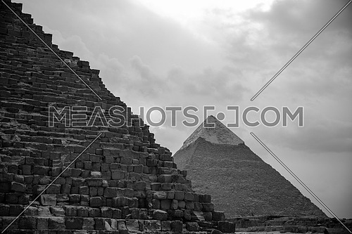 A black and white picture showing the View of the Giza Pyramids in Egypt.