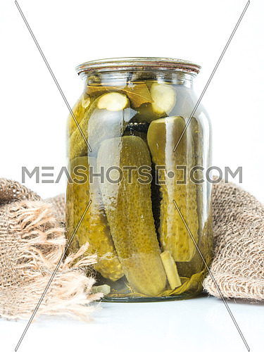 Pickled cucumbers isolated. Pickles in glass jar isolated on white background. Salted cucumber in jar isolated