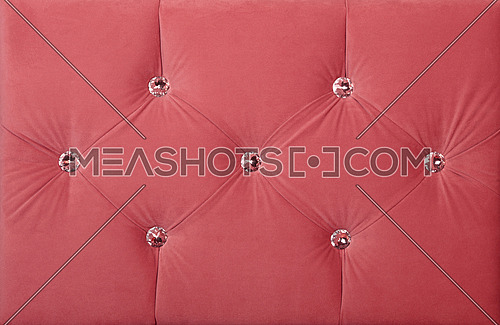 Close up background of pink color soft velvet bed headboard with rhinestone crystals, front view