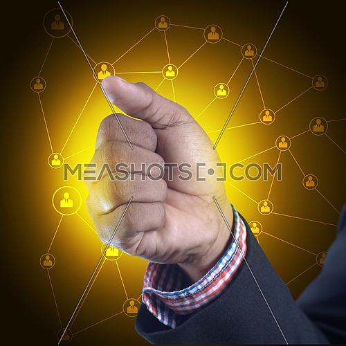 Man showing punching hand in color background