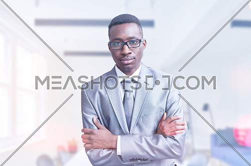 Portrait of young businessman in front of his modern office