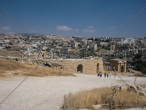 Part of Jarash Historical site in a high end and part of the modern city appears on the background, homes and buildings, Jordan
