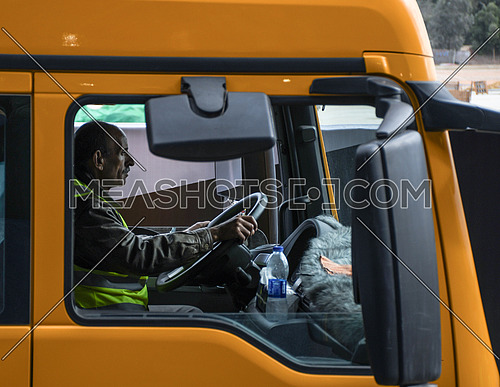 Mid Shot for male driver inside transferring machine which performed The Statue of King Ramses II transferring process to the Grand Egyptian Museum in Cairo on 25 January 2018
