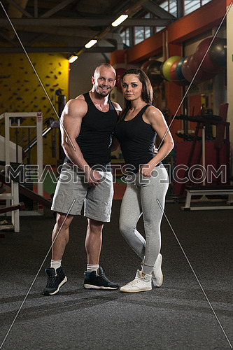 Portrait Of A Sexy Couple In The Gym With Exercise Equipment