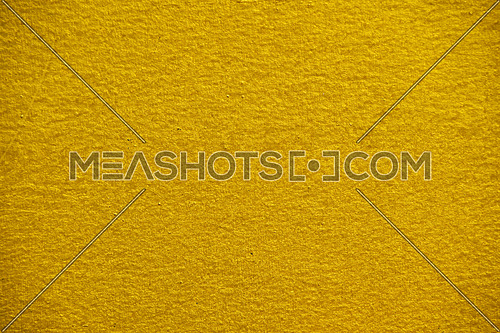 Bright vivid golden yellow pearl nacre uneven painted glossy surface texture background