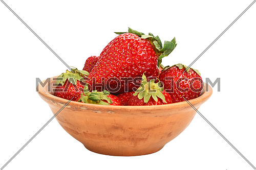 Mellow fresh red summer strawberries in rustic ceramic bowl isolated on white background, side view